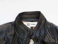Spotty etiket in kledingstuk